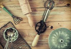 Assorted cooking utensils on a wooden table Stock Photos