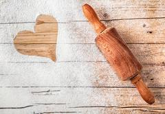 Heart drawn in scattered flour Stock Photos