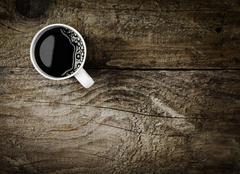 Mug of espresso coffee on rustic wood Stock Photos