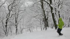 Man hiking on snowshoes in winter forest during a blizzard. Stock Footage