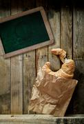 croissant, coffee and a blank school slate - stock photo