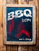 bbq advertised on an old vintage school slate - stock photo