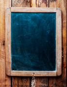 Vintage chalkboard over wood background. Stock Photos