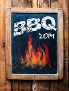 Rustic advertisement for a bbq on a slate Stock Photos