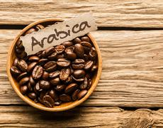 bowl of arabica coffee beans - stock photo