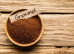 Bowl of ground coffee Stock Photos