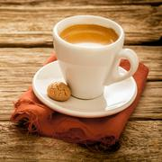 Cup of delicious freshly brewed espresso coffee Stock Photos