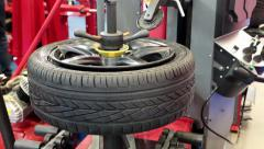 Timelapse 1080p: Tyre fitting. Worker remove the tire Stock Footage