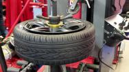 Stock Video Footage of Timelapse 1080p: Tyre fitting. Worker remove the tire