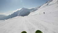 Skiing downhill on a snowy slope, low angle skiing point of view. Stock Footage