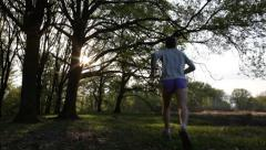 Young man trail running in a forest - HD1080p by Canon 5DMkII - stock footage