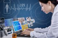 Stock Illustration of busy doctor typing on laptop with digital pictures