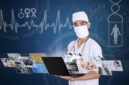 Stock Illustration of doctor looking at digital picture on laptop