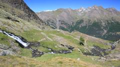 Small mountain river; summer season. Gran Paradiso National Park, Valle d'Aosta, Stock Footage