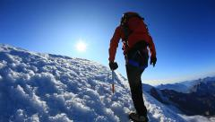 Climber walks along the snowy ridge of Breithorn, Swiss - stock footage