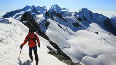 Mountaineer walks along the snowy ridge of Breithorn, exactly on the Stock Footage
