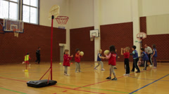 Stock Video Footage of Children playing and learning basketball  in sports hall