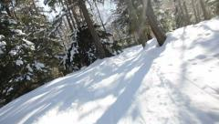 Skiing downhill in a snowed forest, low angle skiing point of view. Stock Footage