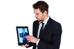Man displaying a handheld tablet computer Stock Photos