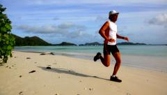Running on a tropical empty beach at sunrise; Seychelles Stock Footage