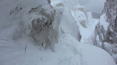 Mountaineer goes down along a steep and dangerous snowy ridge - HD1080p Canon Stock Footage