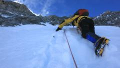 Mountaineer climbs a steep iced mountain. Mont Blanc, France. - stock footage