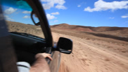 Stock Video Footage of Driving off-road along a dirt road. South Maroc, Africa.