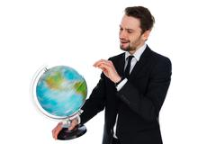 businessman spinning a globe of the world - stock photo