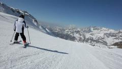 A young skier wipes out while skiing down a slope in Cervinia, Val d'Aosta, West Stock Footage