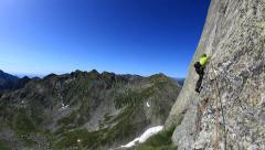 Rock climbing in a wonderful granite wall. Piemonte, Italy, Europe Stock Footage
