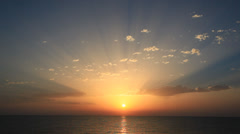 Perfect sunrise on the sea, with rays of sun over a warm colorful horizon. Stock Footage