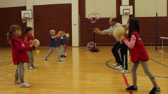 Pupils activities on the class of physical education in sports hall - stock footage