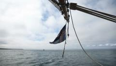 Icelandic flag swinging in the wind aboard a sailship. Husavik bay, Iceland. Stock Footage