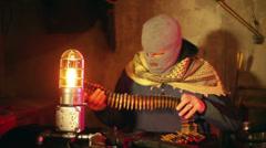 terrorist survivalist ammo counting look - stock footage