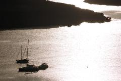 Stock Photo of sailing boats anchored in a harbour at sunrise