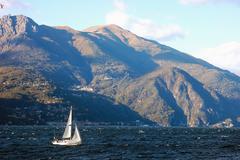 Stock Photo of small sailboat sailing in como lake, italy