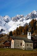 Stock Photo of small church of a mountain village; west alps, italy