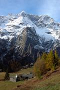 Stock Photo of mountain village during fall season; west alps, italy