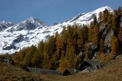 Mountain village during fall season; west alps, italy Stock Photos