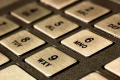 Close-up of metallic keypad of an automated teller machine atm Stock Photos
