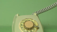 Dialing vintage telephone isolated on green background Stock Footage