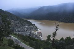 reservoir of the jándula in winter at full capacity after heavy rains, taken - stock photo