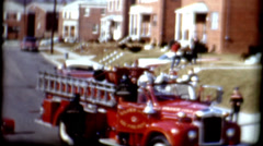 Historic film 1960s fire truck in a neighborhood with firefighters vintage film Stock Footage