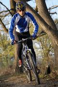 Stock Photo of mountain biker on a single track trail