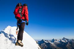 mountaineer on a snowy ridge - stock photo