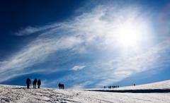 Stock Photo of mountaneers walking on a glacier