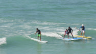 Stock Video Footage of Surfer surfing lesson beginners in Waikiki beach Hawaii