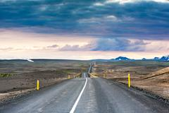 ondulated and empty road in the sub-artic icelandic landscape - stock photo