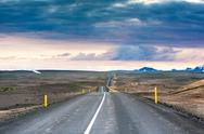 Stock Photo of ondulated and empty road in the sub-artic icelandic landscape