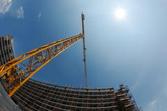 Stock Photo of construction crane and building